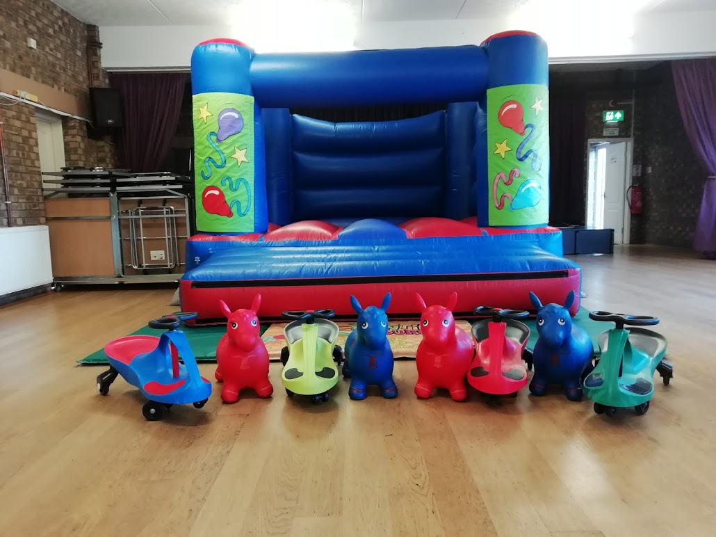 Bouncy Castle And Didy cars at Pinchbeck Village Hall