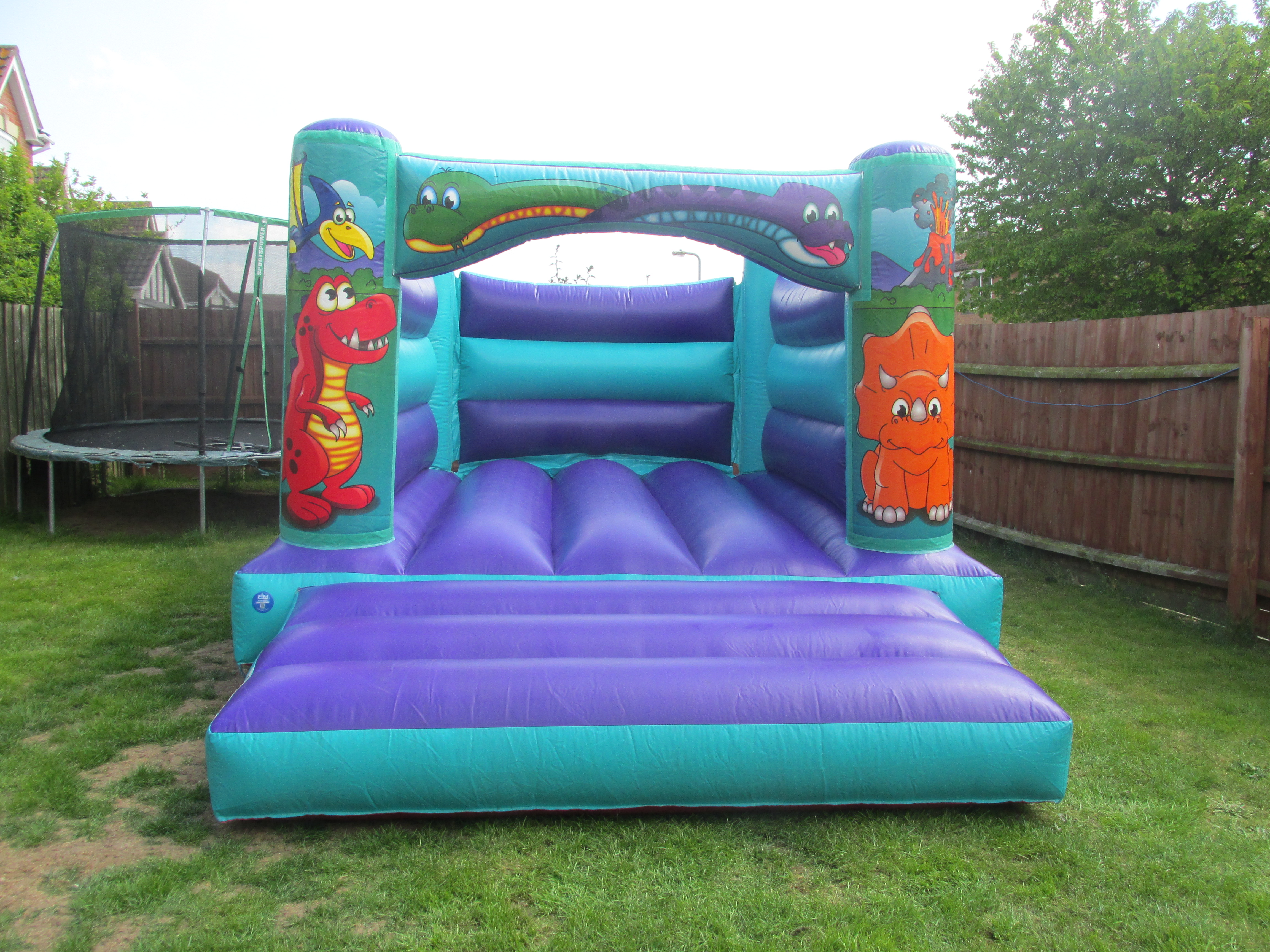 Cartoon Dinosaur Themed Bouncy Castle Hire In Bourne, Peterborough, Grantham and Spalding