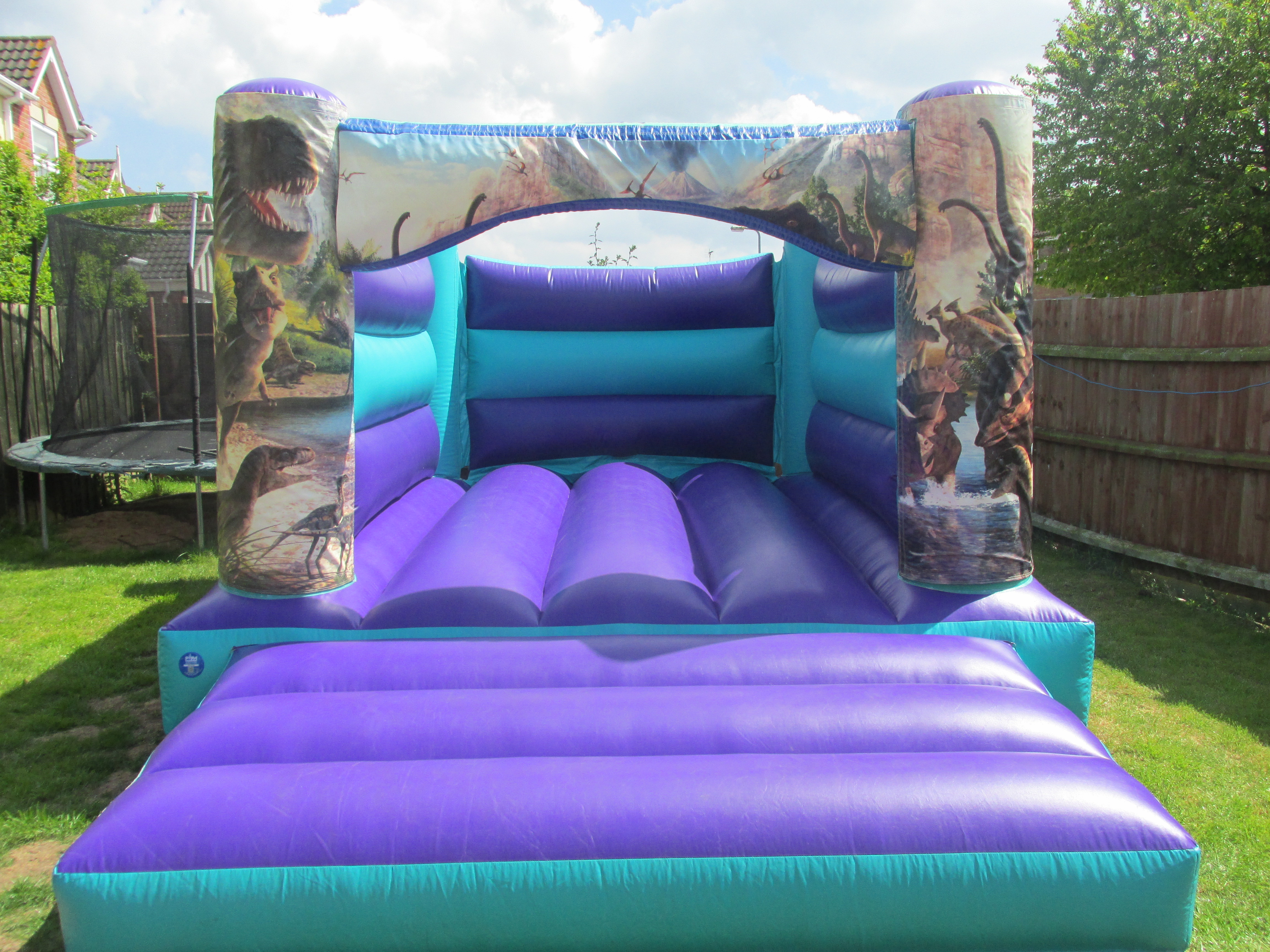 Amazing Jurassic Dinosaur Themed Bouncy Castle Hire In Peterborough, Bourne and Spalding