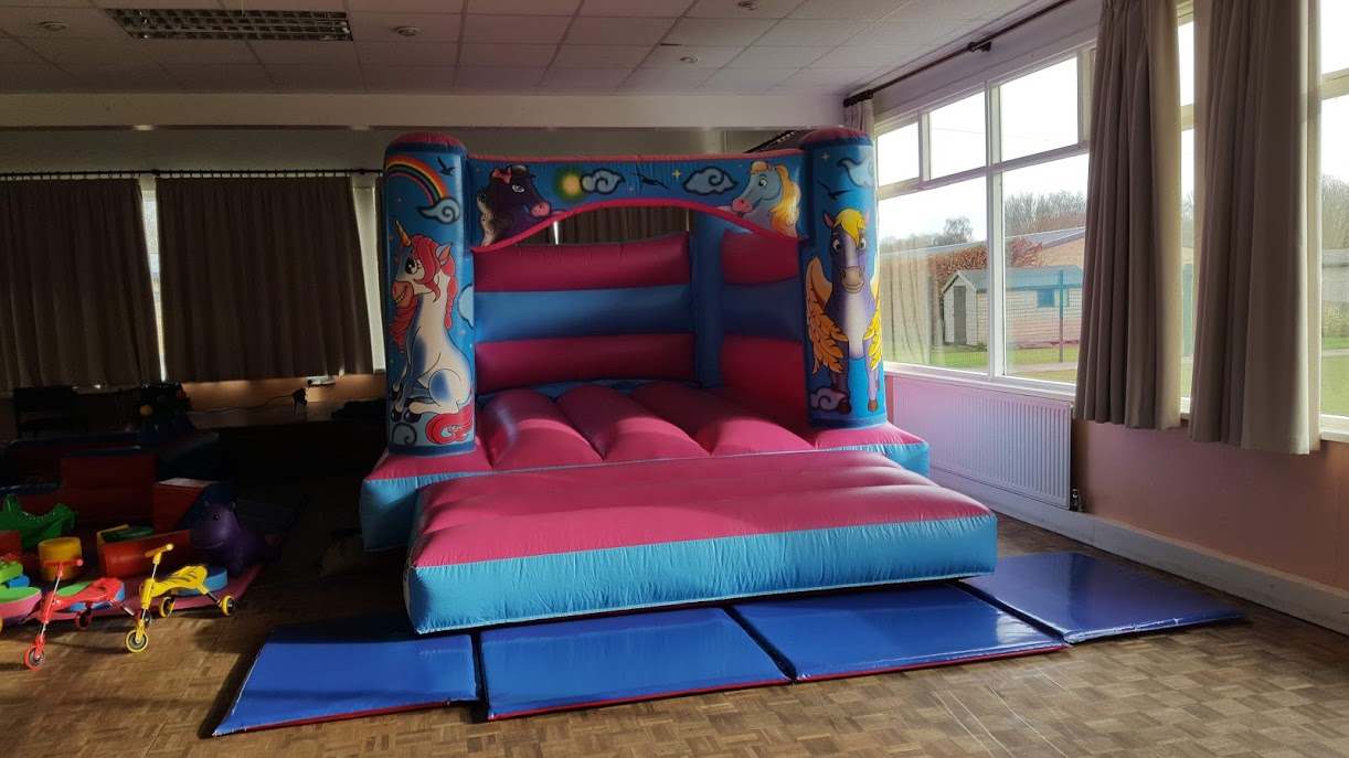 Pink unicorn bouncy castle