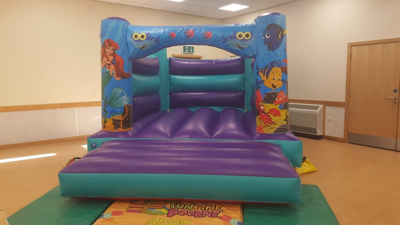 Baby shark, Little Mermaid and Finding Nemo themed bouncy castle hire in Bourne