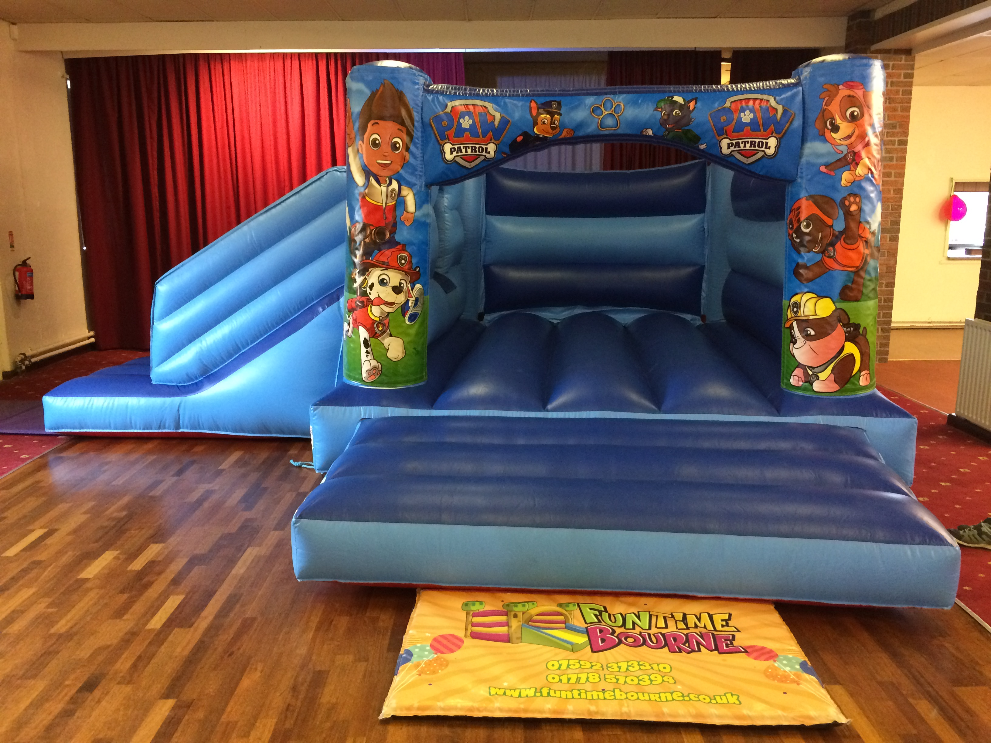 Blue bouncy castle in Billingborough Village Hall
