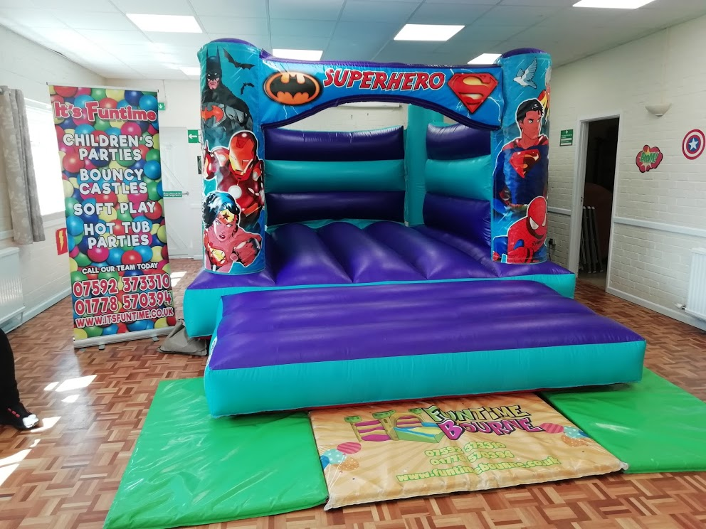 Blue Superheroes Bouncy Castle hire In Bourne, Grantham, Spalding And Peterborough